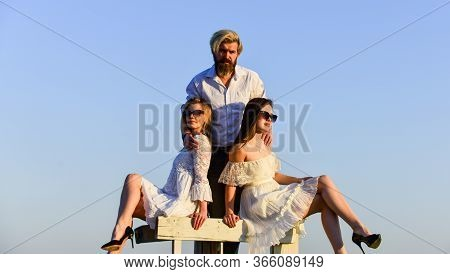 In Love With Both. Rooftop Party. Stylish Hipster And Women White Clothes. Women And Man Cuddling. S