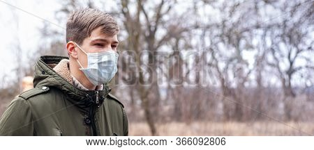Man In A Medical Mask On The Street. Coronavirus Is An Endemic Virus In China. Disease Protection Fo