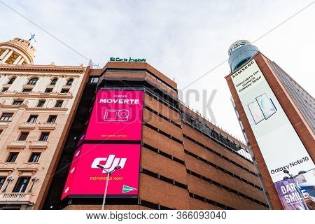 Madrid, Spain - November 1, 2019: Low Angle View Of Large Stores With Advertisement Billboards In Ca