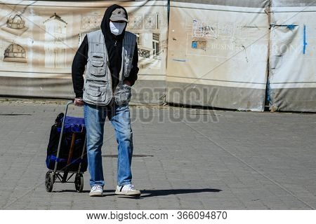 Uzhgorod, Ukraine - May 12, 2020: A Man In A Protective Mask Walking Through The City Center After W