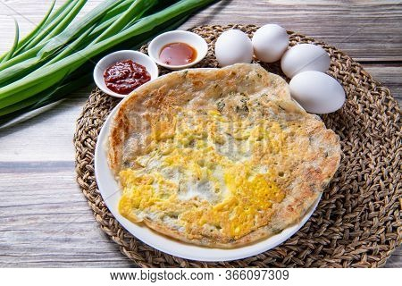 Scallion Pancake, Is A Chinese, Savory, Unleavened Flatbread Folded With Oil And Minced Scallions.