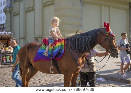 Odessa, Ukraine. July 22th 2018. Horse Decked In Pride Colors. Horse Riding - Little Girl Is Riding