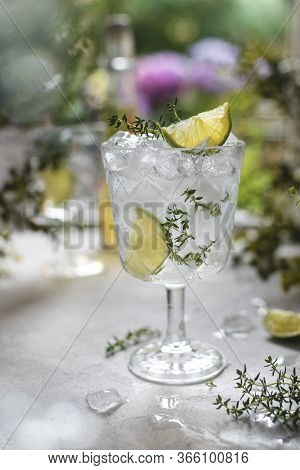 Glass With Cold Iced Refreshing Summer Lemonade With Lime And Thyme