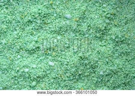 Green Sea Salt Top View Background. Granules Of Sea Salt With The Addition Of Oil Of Pine Needles An