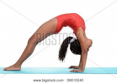 South African child doing gymnastics bridge