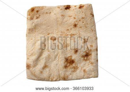 Thin Pita Bread On A White Background Isolate. Armenian Pita Bread - Unleavened Flat Bread, Top View