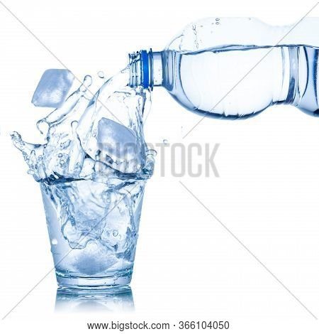 Water Pouring Into Glass Ice Cube Isolated On White