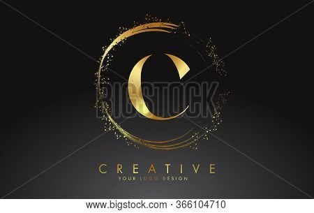 C Golden Letter Logo With Golden Sparkling Rings And Dust Glitter On A Black Background. Luxury Deco