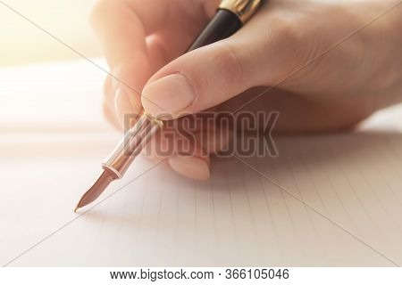 Young Woman Writer Writes Poetry With Fountain Pen On Sheet Of Paper, Warm Sunlight