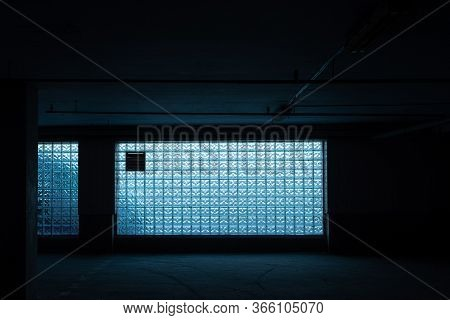 Blue Glass Brick Wall - Seamless Texture. Color Abstraction In Brick Glass Wall. Dark Room With A La