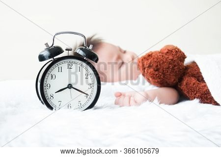 The Little Boy Slept In Bed With A Teddy Bear Sleeping As A Friend. He Is Sick With A Cold. The Morn
