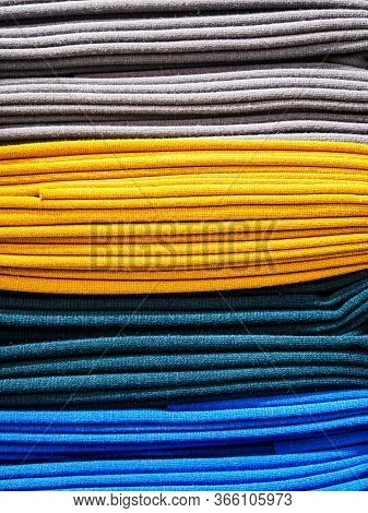 Bright Yellow And Blue Fabric Laid In Layers, Close-up. Background With A Bright And Expressive Fabr