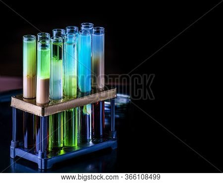 Cocktails In Test Tubes - Creative Alcohol Bar Drinks. Rainbow Liqhuids In Tubes. Copy Space.