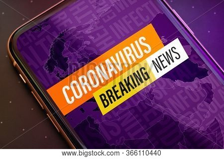 Coronavirus Or Covid-19 Pandemic  Breaking News Update Background Concept. Close Up Mobile Phone Wit