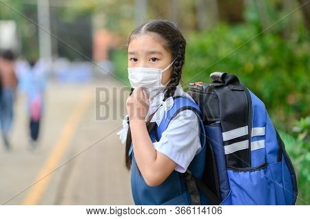 Back To School. Asian Children Girl Wear Mask To  Protection For Coronavirus(covid-19) In The School