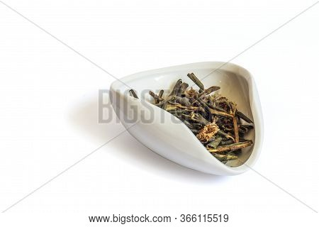 A Pile Of Dried Rhododendron Adamsia In A White Bowl Cha Hae, Sagan Daily For Tea. Isolated On A Whi