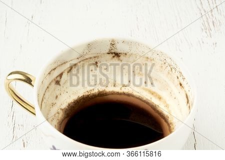 Coffee Cup With Grounds For Fortunetelling From Shapes