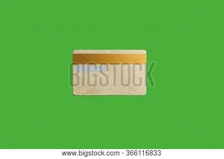 Vip Gold Credit Card Lying Isolated On A Green Background. Concept Of Money Saving. Free Space For T