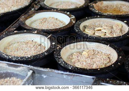 Traditional Malaysian Street Food Apam Balik - Thick Soft Pancake With Peanuts, Bananas, Peanut Butt
