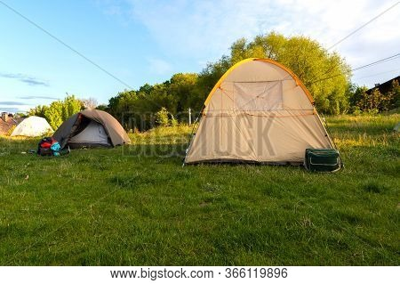 Camping Camp In Nature. Several Tourist Tents. Camping Town. In The Morning At The Campsite.