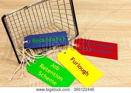 Concept Of Work Issues Relating To The Coronavirus Pandemic - Shopping Basket And Labels With Work R