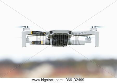 Mariefred, Sweden - May 2, 2020: Frontal View Of A Dji Mavic Mini Quadcopter Drone Hovering In An Ur