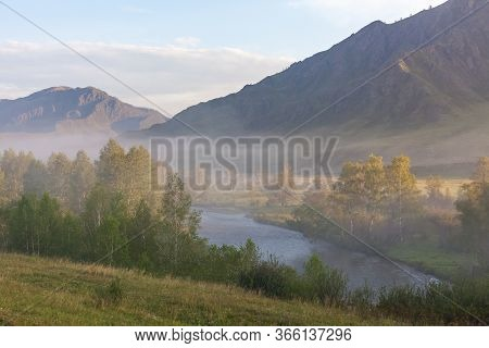 View Of The Altai Mountains. Alpine Valley. Peaks In A Blue Haze.