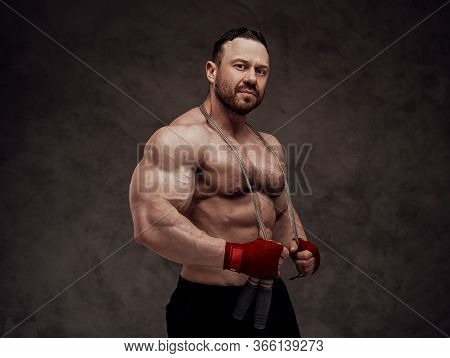 Sportive Adult Male Wearing Sportswear With Naked Torso Posing With A Jumping Rope, Smiling And Look