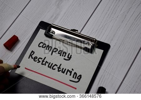 Company Restructuring Write On Paperwork Isolated On Office Desk.