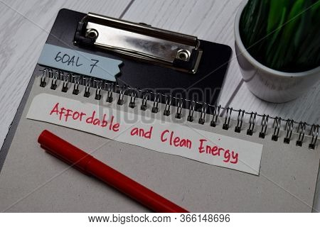 Goal 7 - Affordable And Clean Energy Write On Sticky Notes Isolated On Office Desk