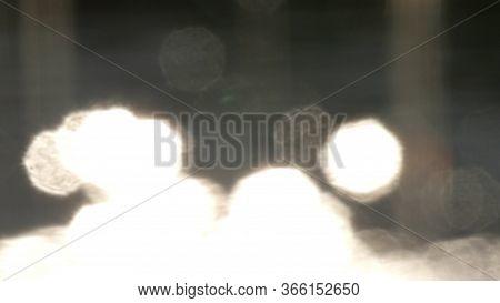 Bokeh Sun Glare Reflected In Water Surface. Sunrays Flickering In Water Surface. Shimmering Water In
