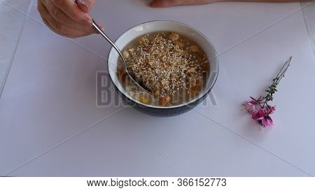Woman Eating Ashure Aka Turkish Noah's Pudding Served With Bowl And Spoon Up.