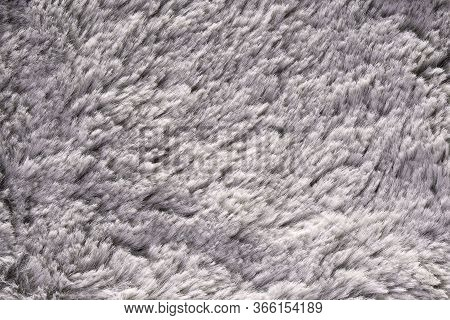 Artificial Fur Texture For Background Close-up. Fluffy Grey Material Backdrop. Kids Toys Faux Fur Te