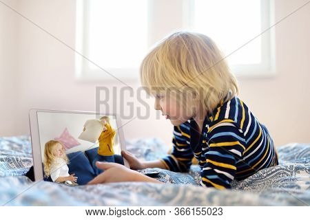 Little Boy Is Meeting With Friends For Play Date In Video Chat While Coronavirus Pandemic. Stay At H