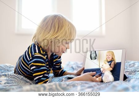Little Boy Is Meeting With Friend For Play Date In Video Chat While Coronavirus Pandemic. Stay At Ho