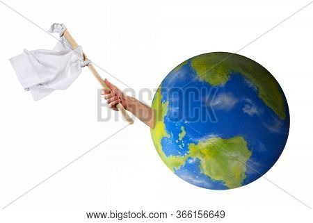 Hand holding white flag asking help surrender from planet earth concept.