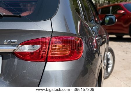 Novosibirsk/ Russia - May 03 2020: Brilliance V5, Glowing Tailight Of A Modern Silver Suv Close-up.