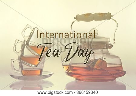 Tea Pot And Three Cup Of Glass. Illustration With The Text: International Tea Day. Illustration With