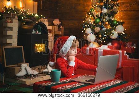 Wish List For Santa. Child Type Letter To Santa. On-line Christmas Shopping For Kids. Little Kid Is