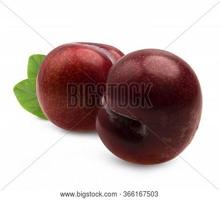 Isolated Plums. Whole And A Half Of Blue Plum Fruit Isolated On White Background, With Clipping Path
