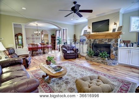 tasteful living and diningrooms with wood and leather furniture