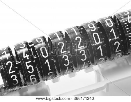 Many Numbers On An Old Analog Type Counter On A White Background