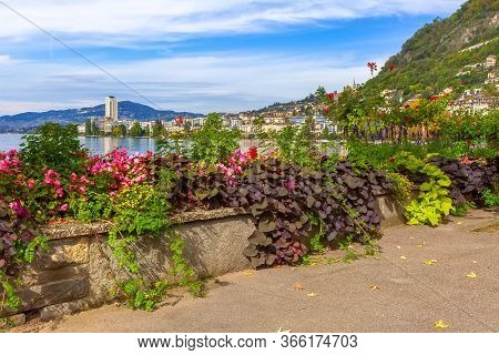 Panoramic View Of Montreux Promenade And Lake Geneva, Switzerland With Flowers And Trees
