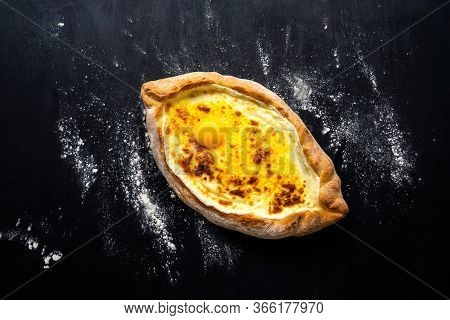Khachapuri Adjara Traditional Georgian Cuisine Meal. Baked Bread As Boat With Cheese And Egg Filling