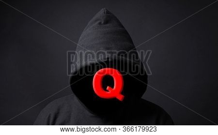 Qanon Conspiracy Theory - Q Symbol On Faceless Person Wearing Black Hoodie