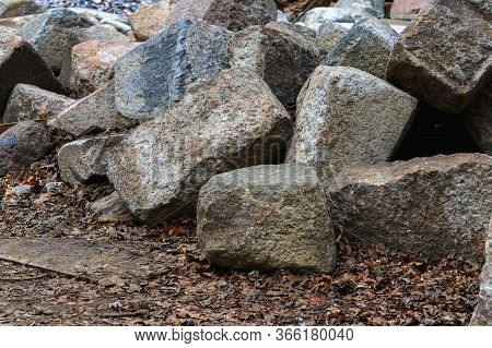 A Pile Of Granite Stones On The Ground. Granite Stones Piled In A Pile.