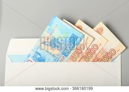 Cash Notes In A White Postal Envelope. Russian Money In A Postal Envelope. Bills In An Envelope.