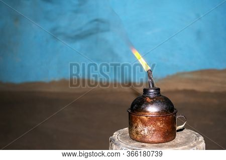 Old-fashioned Or Backdated Clean Oil Lamp Glowing In Indian Village House With Dark Background. Burn