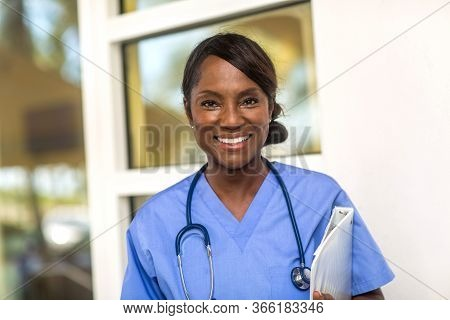 Mature Woman Working As A Health Care Provider.