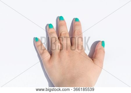 Female Hand With Green Nail Design On White Background.
